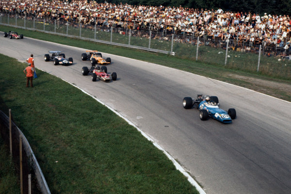 Monza, Italy. 7 September 1969 Jackie Stewart (Matra MS80-Ford), 1st position, lead Graham Hill (Lotus 49B-Ford), 9th position, Bruce McLaren (McLaren M7C-Ford), 4th position and Piers Courage (Brabham BT26-Ford), 5th position, action World Copyright: LAT Photographic. Ref: 69ITA11.