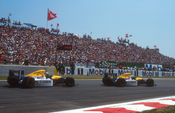 1993 French Grand Prix.Magny-Cours, France.2-4 July 1993.Alain Prost (Williams FW15C Renault) 1st position followed by teammate Damon Hill (Williams FW15C Renault) 2nd position at the Adelaide Hairpin.Ref-93 FRA 03.World Copyright - LAT Photographic
