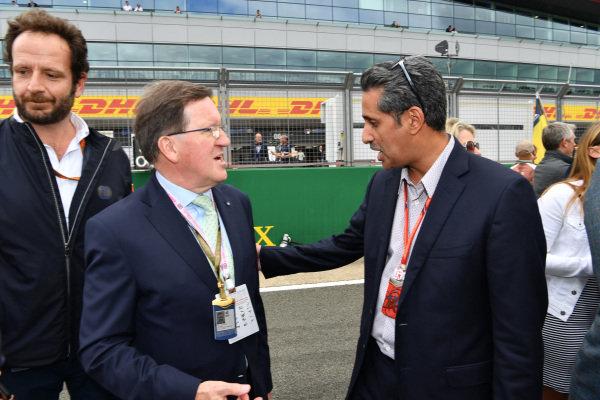 Shaikh Salman bin Isa Al Khalifa (BRN) Chief Executive of Bahrain International Circuit and Lord Robertson (GBR) on the grid at Formula One World Championship, Rd10, British Grand Prix, Race, Silverstone, England, Sunday 16 July 2017.
