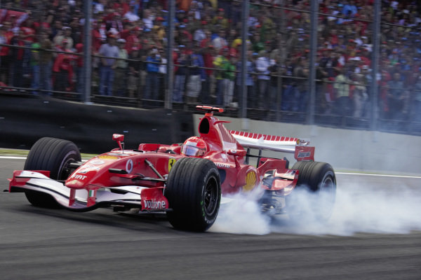 Michael Schumacher, Ferrari 248 F1 locking up into the first corner.