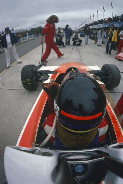 James Hunt waits to go back on track in his McLaren M26 Ford.