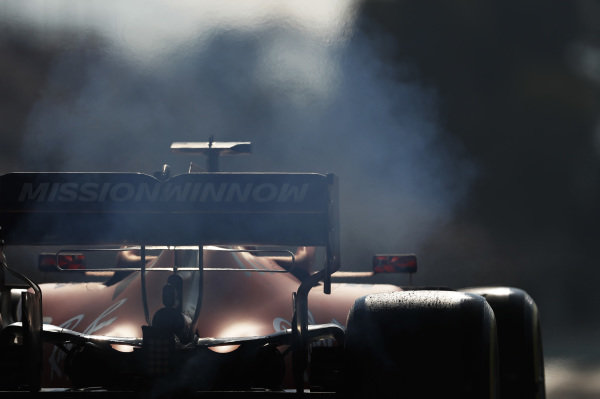 Smoke from the rear of Charles Leclerc, Ferrari SF90