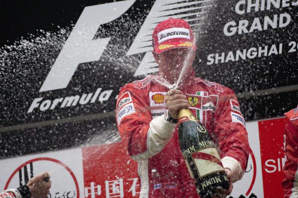 Kimi Räikkönen celebrates victory with a champagne shower.