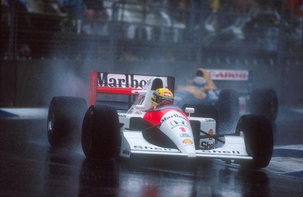 1991 Australian Grand Prix.Adelaide, Australia.1-3 November 1991.Ayrton Senna (McLaren MP4/6 Honda) 1st position with Nigel Mansell (Williams FW14 Renault) behind.Ref-91 AUS 04.World Copyright - LAT Photographic