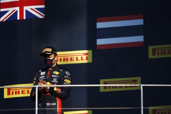 Alexander Albon, Red Bull Racing, celebrates on the podium