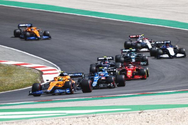 Lando Norris, McLaren MCL35M, leads Esteban Ocon, Alpine A521, Charles Leclerc, Ferrari SF21, Pierre Gasly, AlphaTauri AT02, Sebastian Vettel, Aston Martin AMR21, George Russell, Williams FW43B, Antonio Giovinazzi, Alfa Romeo Racing C41, and Daniel Ricciardo, McLaren MCL35M