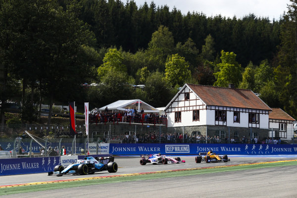 George Russell, Williams Racing FW42, leads Carlos Sainz Jr., McLaren MCL34, and Lance Stroll, Racing Point RP19