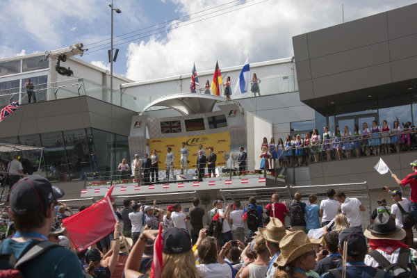 The crowds gather to watch the podium ceremony.