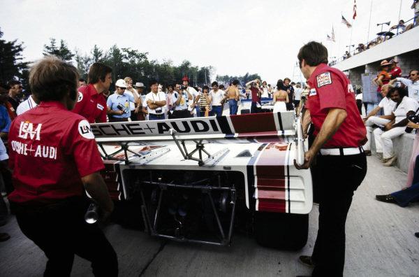 Mechanics work on the car of George Follmer, Penske Racing, Porsche 917/10 TC.