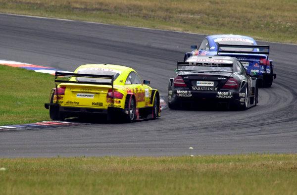 2002 DTM Championship Lausitzring, Germany. 12th - 14th July 2002. Mattias Ekstrom (Abt Audi TT-R), battles with Marcel Fassler (AMG Mercedes CLK) and Laurent Aiello (Abt Audi TT-R), action.World Copyright: Andre Irlmeier/LAT Photographic ref: Digital Image Only