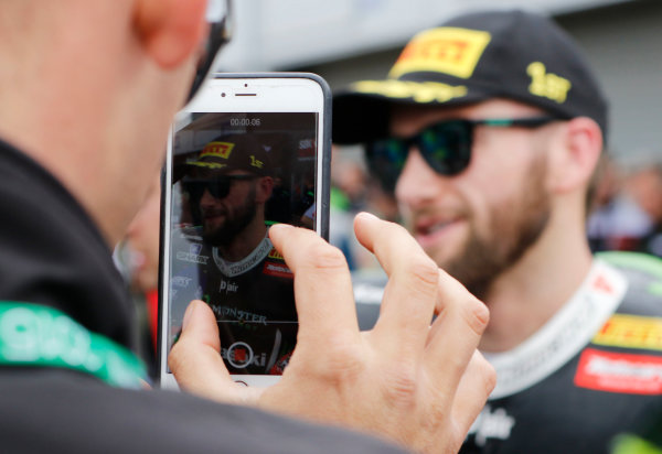 2015 World Superbike Championship.  Donington Park, UK.  23rd - 24th May 2015.  Tom Sykes, Kawasaki, is filmed on a mobile phone.  Ref: KW7_7184a. World copyright: Kevin Wood/LAT Photographic