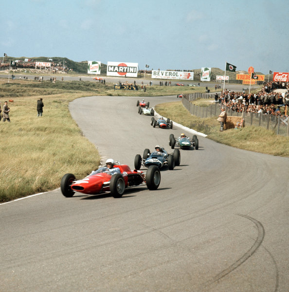 Zandvoort, Holland.21-23 May 1963.Phil Hill (ATS 100) leads Jo Bonnier (Cooper T60 Climax), Trevor Taylor (Lotus 25 Climax), Chris Amon (Lola Mk4A Climax) and Innes Ireland (BRP 1-BRM).Ref-3/0967.World Copyright - LAT Photographic