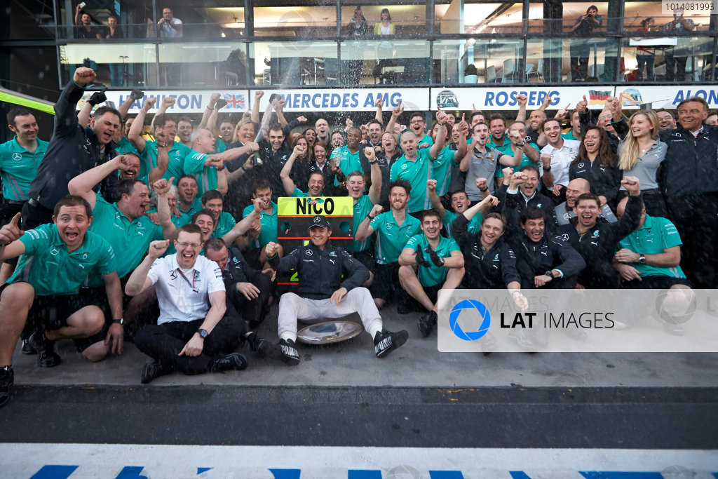 Albert Park, Melbourne, Australia. Sunday 16 March 2014. Nico Rosberg, Mercedes AMG, 1st Position, celebrates with his team. World Copyright: Steve Etherington/LAT Photographic. ref: Digital Image SNE13842 copy