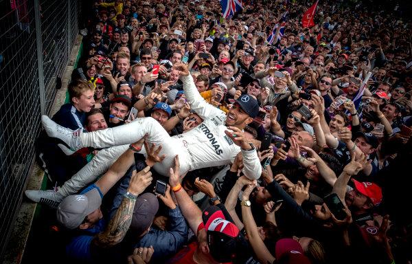 Silverstone, Northamptonshire, UK.  Sunday 16 July 2017. Lewis Hamilton, Mercedes AMG, 1st Position, celebrates victory with some crowd surfing. World Copyright: Dunbar/LAT Images  ref: Digital Image _X4I8779
