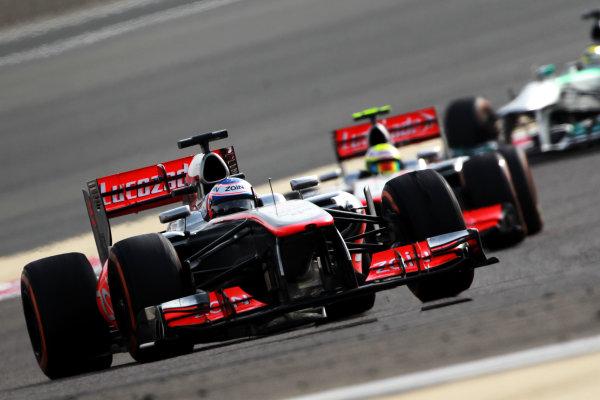 Bahrain International Circuit, Sakhir, Bahrain Sunday 21st April 2013 Jenson Button, McLaren MP4-28 Mercedes, leads Sergio Perez, McLaren MP4-28 Mercedes.  World Copyright: Andy Hone/LAT Photographic ref: Digital Image HONY1463