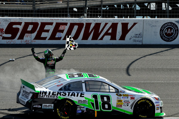22-24 March 2013, Fontana, California USA Kyle Busch, Interstate Batteries Toyota Camry Celebrates the win with the checkered flag ©2013, Scott R LePage LAT Photo USA