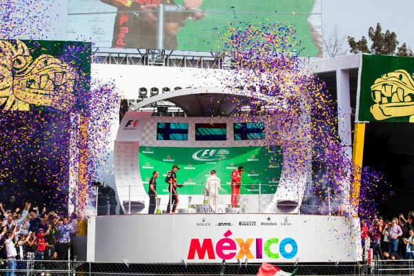 Autodromo Hermanos Rodriguez, Mexico City, Mexico. Sunday 29 October 2017. Winner Max Verstappen, Red Bull Racing, Valtteri Bottas, Mercedes AMG, 2nd, and Kimi Raikkonen, Ferrari, celebrate on the podium. World Copyright: Sam Bloxham/LAT Images  ref: Digital Image _J6I0653