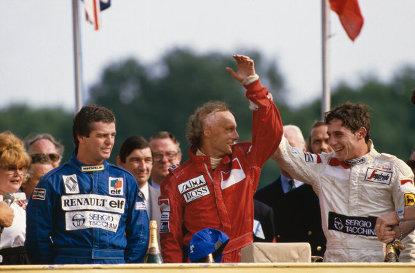 Brands Hatch, England. 20th - 22nd July 1984. Niki Lauda (McLaren MP4-2 TAG Porsche) 1st position, Derek Warwick (Renault RE50), 2nd position and Ayrton Senna (Toleman TG184-Hart), 3rd position, on the podium, portrait.  World Copyright: LAT Photographic.  Ref:  84 GB 11.