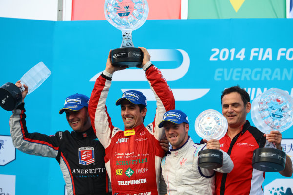 FIA Formula E -  Podium Beijing E-Prix, China Saturday 13 September 2014. Lucas di Grassi (Abt) celebrates with Franck Montagny (Andretti) and Sam Bird (Virgin) on the podium after winning the race. Photo: Malcolm Griffiths/LAT/ Formula E ref: Digital Image F80P2493