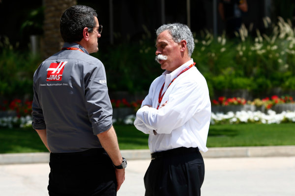 Bahrain International Circuit, Sakhir, Bahrain.  Friday 14 April 2017. Guenther Steiner with Chase Carey  World Copyright: Andy Hone/LAT Images ref: Digital Image _ONZ7292