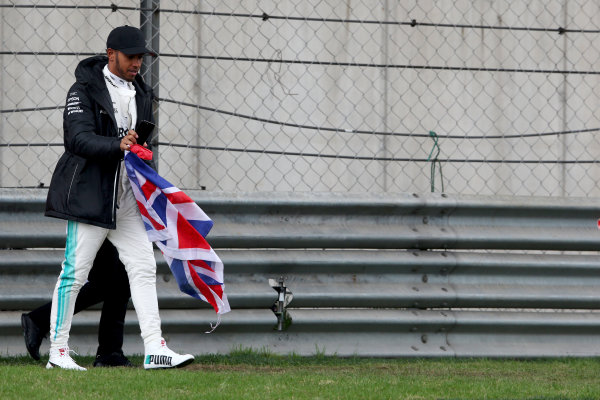 Shanghai International Circuit, Shanghai, China.  Friday 07 April 2017.  Lewis Hamilton, Mercedes AMG, takes to the track to entertain the fans and picks up a Union Flag. World Copyright: Charles Coates/LAT Images  ref: Digital Image AN7T4829