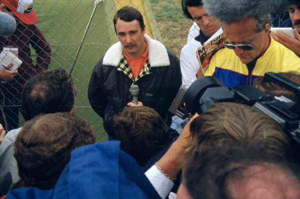 1986 Australian Grand PrixAdelaide, Australia. 24th - 26th October.Nigel Mansell (Williams FW11 Honda) gives an interview to the press. Portrait.World Copyright: LAT Photographicref: 86 AUS 30