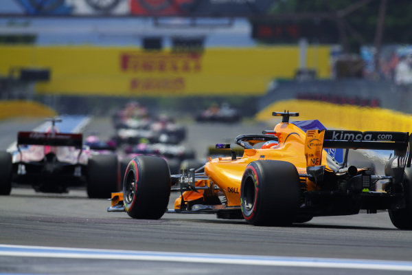 Marcus Ericsson, Sauber C37 Ferrari, leads Fernando Alonso, McLaren MCL33 Renault.