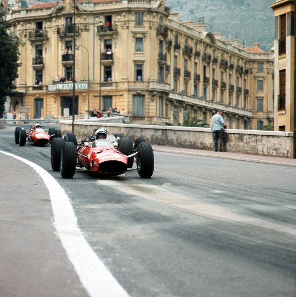 Monte Carlo, Monaco.7-10 May 1964.Lorenzo Bandini (Ferrari Dino 156) leads Jack Brabham (Brabham BT7 Climax) and John Surtees (Ferrari 158).Ref-3/1637.World Copyright - LAT Photographic
