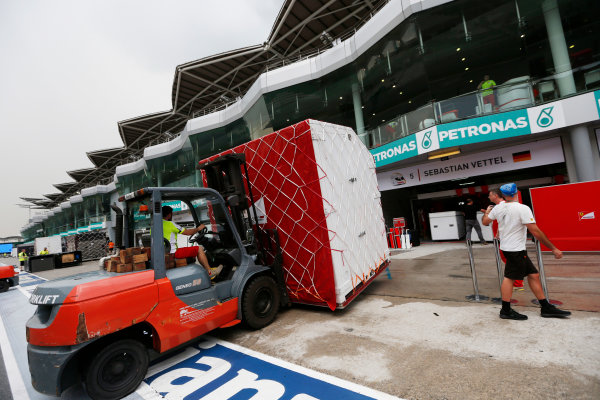 Sepang International Circuit, Sepang, Kuala Lumpur, Malaysia. Sunday 29 March 2015. The Ferrari team pack their equipment after a successful race weekend. World Copyright: Alastair Staley/LAT Photographic. ref: Digital Image _79P9809