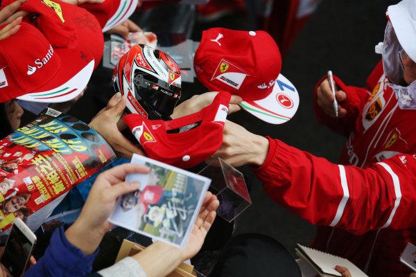 Shanghai International Circuit, Shanghai, China.  Thursday 06 April 2017.  Kimi Raikkonen, Ferrari, signs autographs for fans. World Copyright: Charles Coates/LAT Images  ref: Digital Image GJ9R7364
