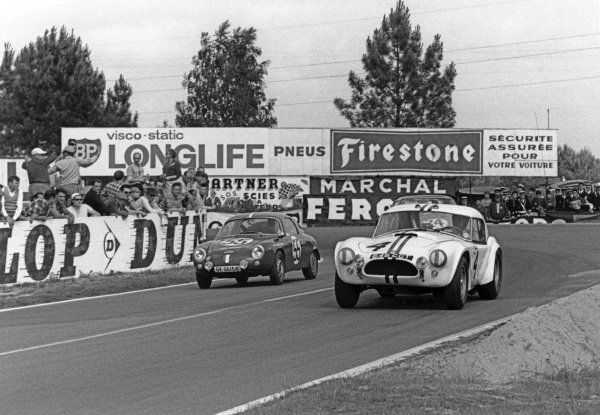 Le Mans, France. 15th - 16th June 1963.Ed Hugus/Peter Jopp (AC Cobra Ford), retired, passes Sarayac/Lucien Barthe (Fiat-Abarth 1000P), retired, action. World Copyright: LAT Photographic.Ref:  10451F - 22.