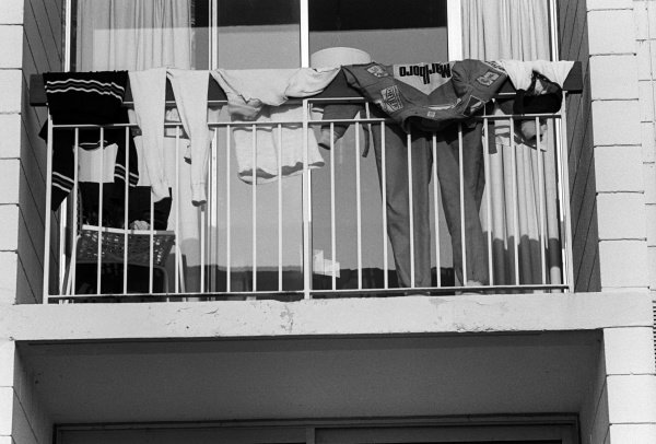 Niki Lauda (AUT) Ferrari leaves his overalls on the apartment balcony to dry. Canadian Grand Prix, Rd14, Mosport Park, Canada, 3 October 1976.