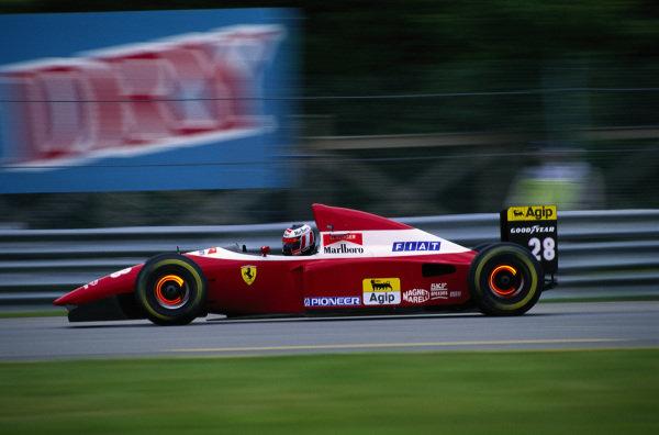 Gerhard Berger, Ferrari F93A, with brake discs glowing.