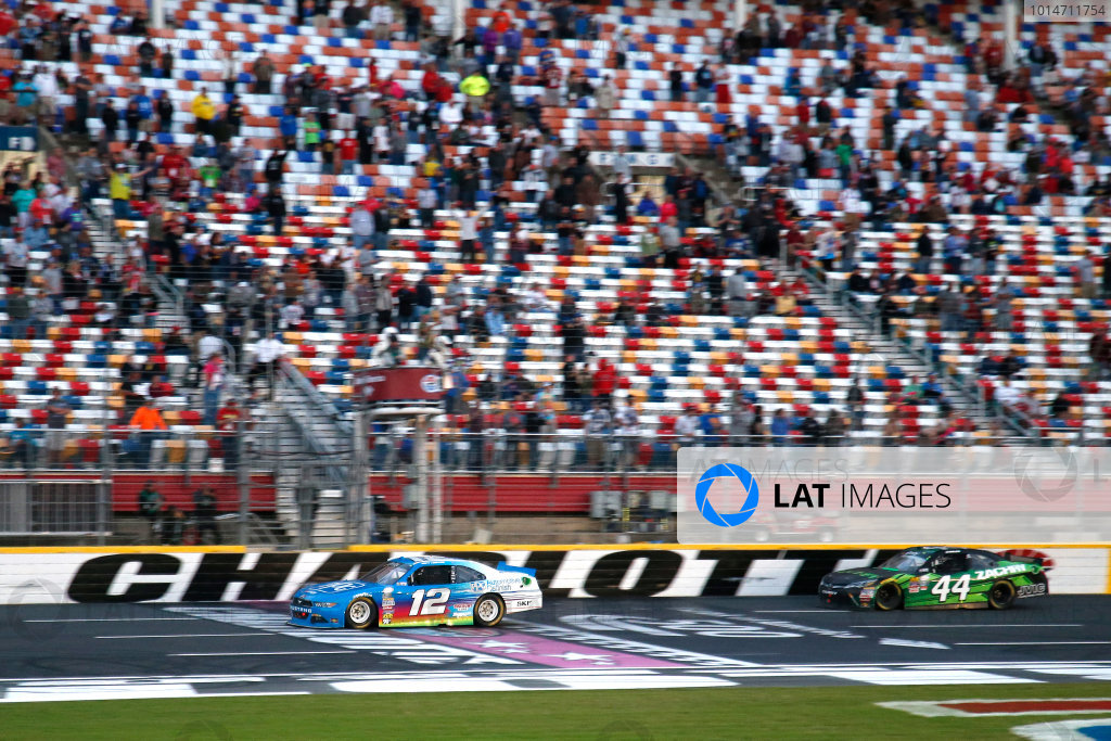 6-7 October, 2016, Concord, North Carolina USA Joey Logano takes the checkered flag to win the race ?2016, Lesley Ann Miller LAT Photo USA