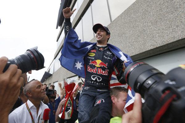 Circuit Gilles Villeneuve, Montreal, Canada. Sunday 8 June 2014. Daniel Ricciardo, Red Bull Racing, 1st Position, celebrates with his team. World Copyright: Alastair Staley/LAT Photographic. ref: Digital Image _79P1320