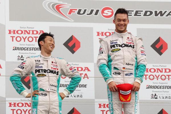 Fuji Speedway, Japan. 15th July 2012.Winner Andre Lotterer ( #1 PETRONAS TEAM TOM'S ) 1st position, Kazuki Nakajima ( #2 PETRONAS TEAM TOM'S ), 2nd position.   Podium.World Copyright: Yasushi Ishihara/LAT Photographicref: Digital Image 2012FN_Rd4_008