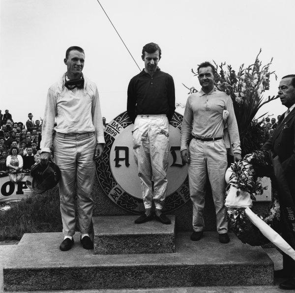 Avus, Germany. 31st July - 2nd August 1959.Dan Gurney (Ferrari Dino 246), 3rd position with Tony Brooks (Ferrari Dino 246), 1st position and Phil Hill (Ferrari Dino 246), 2nd position, on the podium, portrait. World Copyright: LAT Photographic.Ref:  4663