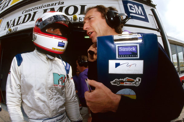 (L to R): Roland Ratzenberger (AUT) Simtek, who was tragically killed in a crash during the Saturday qualifying session, talks with his race engineer Humphrey Corbett (GBR). Formula One World Championship, Rd 3, San Marino Grand Prix, San Marino, Italy, 29 April - 1 May 1994.