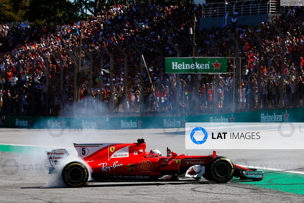 Interlagos, Sao Paulo, Brazil. Sunday 12 November 2017. Sebastian Vettel, Ferrari SF70H, performs doughnuts as he returns to the pits after winning the race. World Copyright: Glenn Dunbar/LAT Images  ref: Digital Image _31I4276