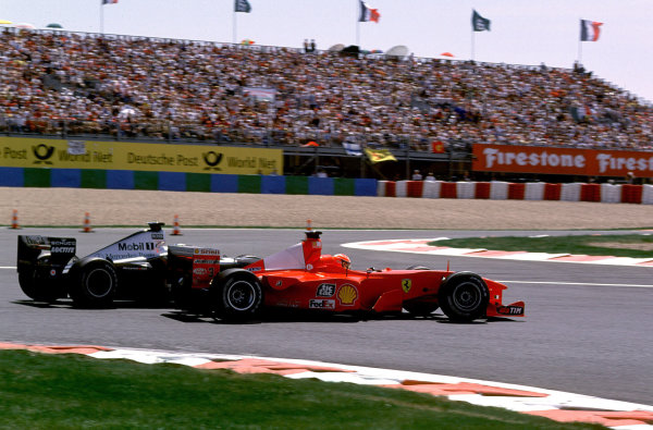2000 French Grand Prix.Magny-Cours, France. 30/6-2/7 2000.Michael Schumacher (Ferrari F1-2000) just manages to keep David Coulthard (McLaren MP4/15 Mercedes) from overtaking at the Hairpin.World Copyright - LAT PhotographicFormat: 35mm transparency