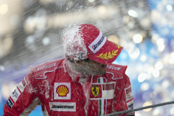 Champagne shower for race winner Felipe Massa.