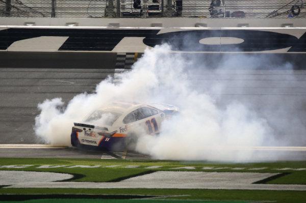 #11: Denny Hamlin, Joe Gibbs Racing, Toyota Camry FedEx Express celebrates his second win of the Daytona 500 on Sunday 17, February 2019 in Daytona, Florida.
