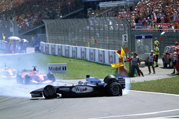 Kimi Räikkönen, McLaren MP4-17D Mercedes, spins off after a collision with Rubens Barrichello, Ferrari F2003-GA, at the start.