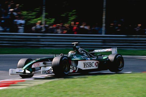 2002 Italian Grand PrixMonza, Italy. 14th - 16th September 2002Eddie Irvine, Jaguar Cosworth R3 - 3rd placeWorld Copyright - LAT Photographicref: 35mm Transparency 02_ITA_22