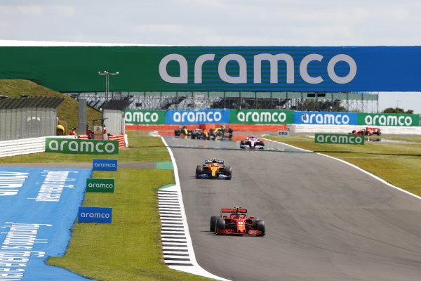 Charles Leclerc, Ferrari SF1000, leads Lando Norris, McLaren MCL35