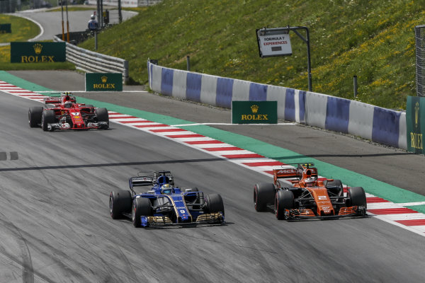 Stoffel Vandoorne (BEL) McLaren MCL32 and Marcus Ericsson (SWE) Sauber C36 at Formula One World Championship, Rd9, Austrian Grand Prix, Race, Spielberg, Austria, Sunday 9 July 2017.