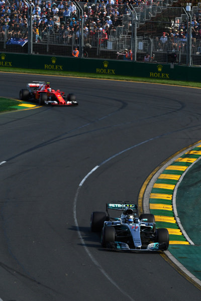 Valtteri Bottas (FIN) Mercedes-Benz F1 W08 Hybrid leads Kimi Raikkonen (FIN) Ferrari SF70-H at Formula One World Championship, Rd1, Australian Grand Prix, Race, Albert Park, Melbourne, Australia, Sunday 26 March 2017.