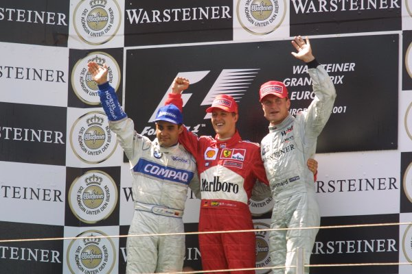 2001 European Grand Prix. RACENurburgring, Germany. 24th June 2001Michael Schumacher, Ferrari F2001 (1st), Juan Pablo Montoya, BMW Williams FW23 (2nd) and David Coulthard, West McLaren Mercedes MP4/16 (3rd) - podium.World Copyright - LAT Photographicref: 8 9 MB Digital File Only