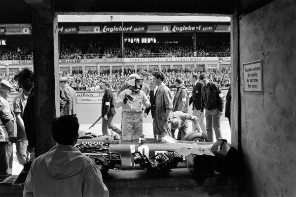 Jackie Stewart, BRM P261, in the pit lane.