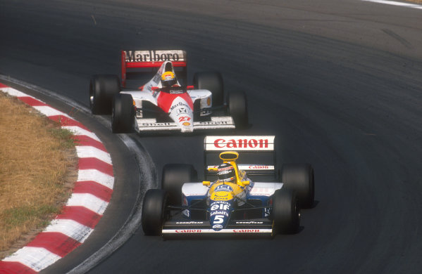 1990 Hungarian Grand Prix.Hungaroring, Budapest, Hungary.10-12 August 1990.Thierry Boutsen (Williams FW13B Renault) leads Ayrton Senna (McLaren MP4/5B Honda). They finished in 1st and 2nd positions respectively.Ref-90 HUN 05.World Copyright - LAT Photographic